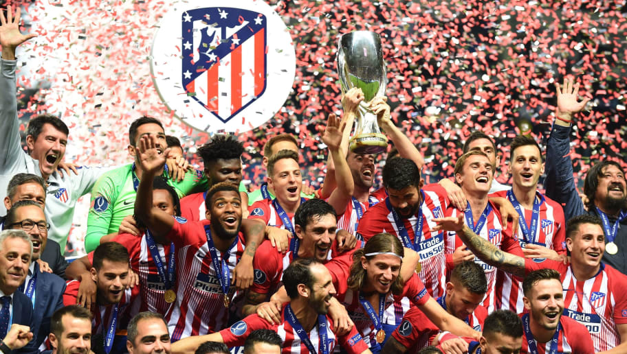 Atletico Madrid's players celebrate with the trophy after winning the UEFA Super Cup football match Atletico de Madrid vs Real Madrid CF at the Lillekula Stadium in Tallinn, Estonia, on August 15, 2018. (Photo by Janek SKARZYNSKI / AFP)        (Photo credit should read JANEK SKARZYNSKI/AFP/Getty Images)
