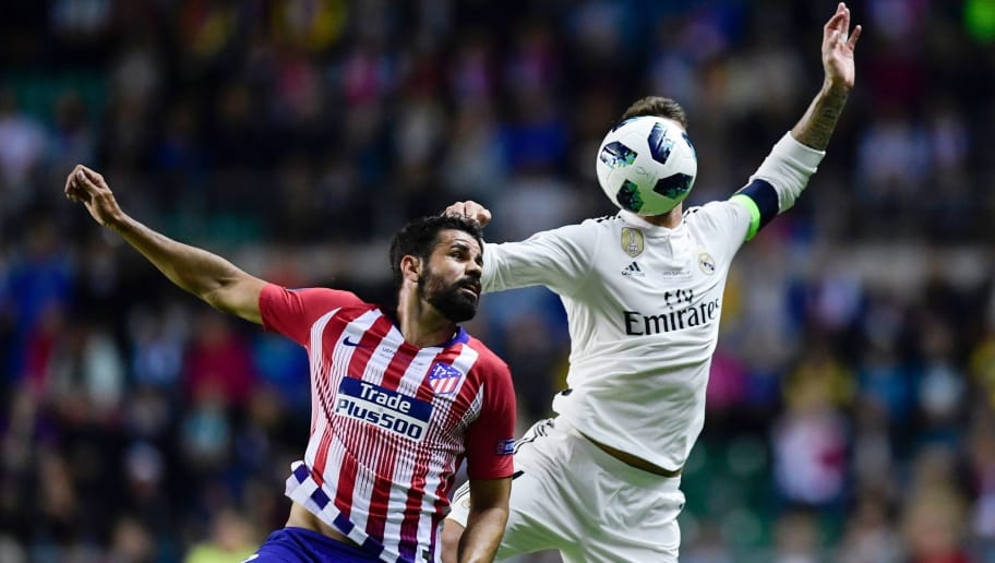Real Madrid's Spanish defender Sergio Ramos (R) heads the ball with Atletico Madrid's Spanish forward Diego Costa during the UEFA Super Cup football match between Real Madrid and Atletico Madrid at the Lillekula Stadium in the Estonian capital Tallinn on August 15, 2018. (Photo by JAVIER SORIANO / AFP)        (Photo credit should read JAVIER SORIANO/AFP/Getty Images)