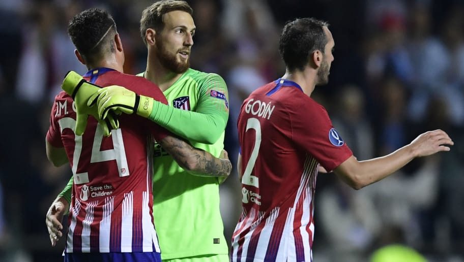 (L-R) Atletico Madrid's Uruguayan defender Jose Gimenez, Atletico Madrid's Slovenian goalkeeper Jan Oblak and Atletico Madrid's Uruguayan defender Diego Godin celebrate at the end of the UEFA Super Cup football match between Real Madrid and Atletico Madrid at the Lillekula Stadium in the Estonian capital Tallinn on August 15, 2018. (Photo by JAVIER SORIANO / AFP)        (Photo credit should read JAVIER SORIANO/AFP/Getty Images)