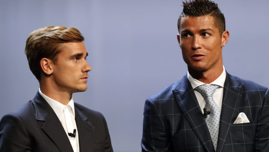 Real Madrid's Portuguese forward Cristiano Ronaldo  (R) stands next to Atletico Madrid's French forward Antoine Griezmann at the end of the UEFA Champions League Group stage draw ceremony, on August 25, 2016 in Monaco. AFP PHOTO / VALERY HACHE / AFP / VALERY HACHE        (Photo credit should read VALERY HACHE/AFP/Getty Images)