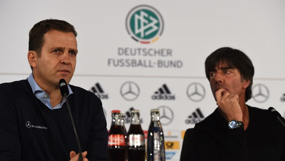 Germany's head coach Joachim Loew (R) and team manager Oliver Bierhoff address a press conference on the eve of the friendly football match Germany vs the Netherlands in Barsinghausen, Germany on November 16, 2015. AFP PHOTO / PATRIK STOLLARZ        (Photo credit should read PATRIK STOLLARZ/AFP/Getty Images)