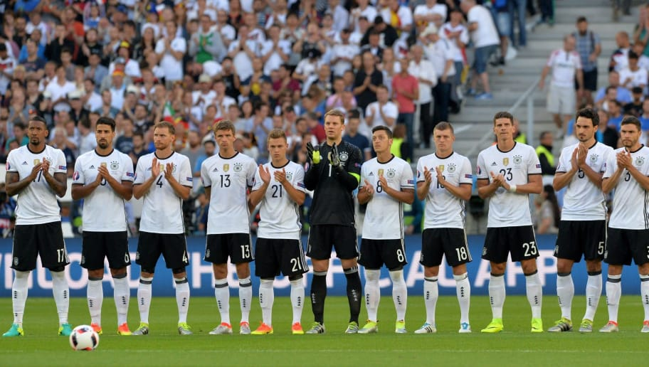 From left : Germany's defender Jerome Boateng, Germany's midfielder Sami Khedira, Germany's defender Benedikt Hoewedes, Germany's midfielder Thomas Mueller, Germany's midfielder Joshua Kimmich, Germany's goalkeeper Manuel Neuer, Germany's midfielder Mesut Oezil, Germany's midfielder Toni Kroos, Germany's forward Mario Gomez, Germany's defender Mats Hummels and Germany's defender Jonas Hector clap during a moment of silence following the deadly attack in the Bangladeshi capital Dhaka in wich some 20 people were killed including Italians and other foreigners prior to the Euro 2016 quarter-final football match between Germany and Italy at the Matmut Atlantique stadium in Bordeaux on July 2, 2016.  / AFP / NICOLAS TUCAT        (Photo credit should read NICOLAS TUCAT/AFP/Getty Images)