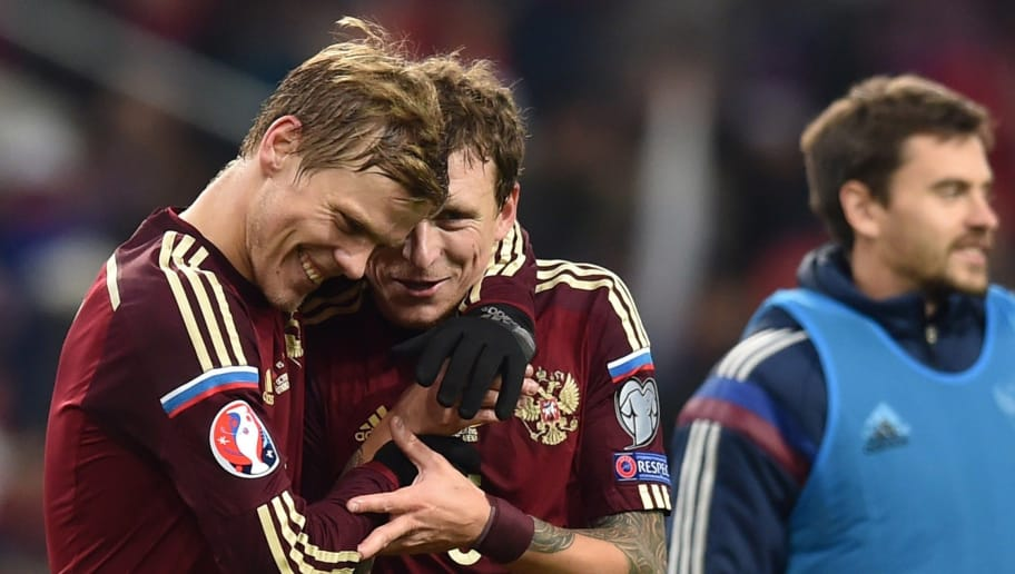 Russia's forward Aleksandr Kokorin (L) and Russia's midfielder Pavel Mamaev celebrate their victory over Montenegro after the UEFA Euro 2016 group G qualifying football match between Russia and Montenegro at the Otkrytie Arena stadium in Moscow on October 12, 2015.  AFP PHOTO / KIRILL KUDRYAVTSEV        (Photo credit should read KIRILL KUDRYAVTSEV/AFP/Getty Images)