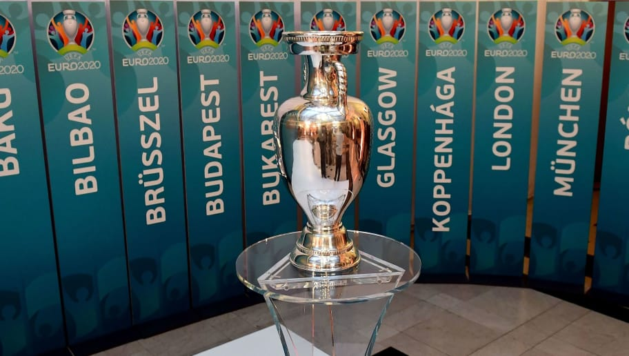 A model of the UEFA European football championship trophy is pictured surrounded with the names of host cities after an event to launch the Budapest's logo for the 2020 UEFA European Championship football tournament in Budapest on November 16, 2016.  The EURO 2020 UEFA European Championship will see matches hosted in 13 cities across Europe, with the semi-finals and final staged at Wembley Stadium in London in July 2020. / AFP / ATTILA KISBENEDEK        (Photo credit should read ATTILA KISBENEDEK/AFP/Getty Images)