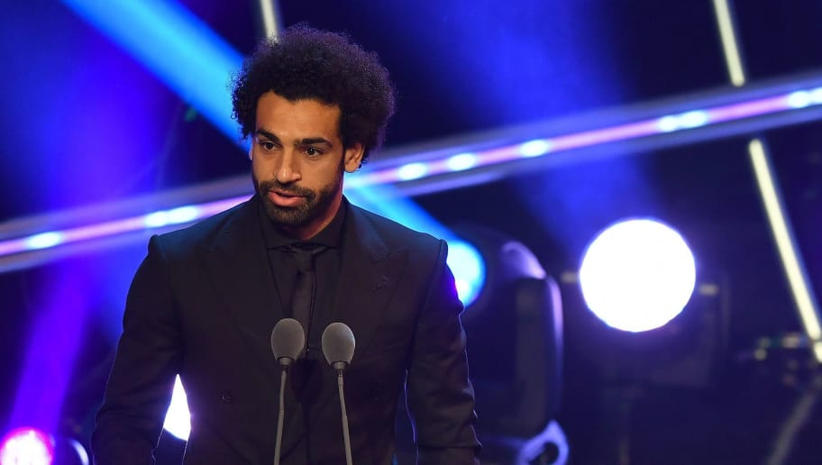 Liverpool and Egypt forward Mohamed Salah (L) speaks after being presented with the trophy for the FIFA Puskas Award for 2018, the best goal scored between July 2017 and July 2018 during The Best FIFA Football Awards ceremony, on September 24, 2018 in London. (Photo by Ben STANSALL / AFP)        (Photo credit should read BEN STANSALL/AFP/Getty Images)