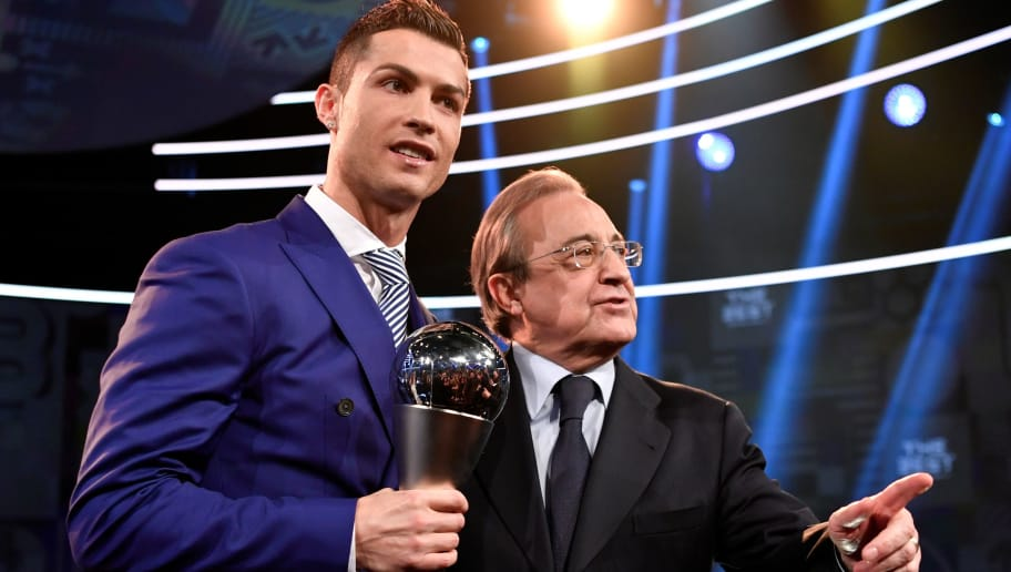 Real Madrid and Portugal's forward and winner of The Best FIFA Mens Player of 2016 Award Cristiano Ronaldo (L) poses on stage with his trophy next to Real Madrid President Florentino Perez following The Best FIFA Football Awards 2016 ceremony, on January 9, 2017 in Zurich. / AFP / Fabrice COFFRINI        (Photo credit should read FABRICE COFFRINI/AFP/Getty Images)