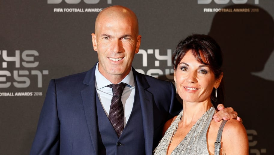 Real Madrid's French coach Zinedine Zidane and his wife Veronique arrive for The Best FIFA Football Awards ceremony, on September 24, 2018 in London. (Photo by Adrian DENNIS / AFP)        (Photo credit should read ADRIAN DENNIS/AFP/Getty Images)