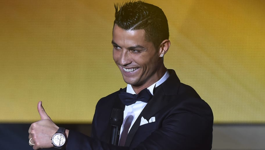 Real Madrid and Portugal's forward  Cristiano Ronaldo gestures on stage during the 2015 FIFA Ballon d'Or award ceremony at the Kongresshaus in Zurich on January 11, 2016. AFP PHOTO / OLIVIER MORIN / AFP / OLIVIER MORIN        (Photo credit should read OLIVIER MORIN/AFP/Getty Images)