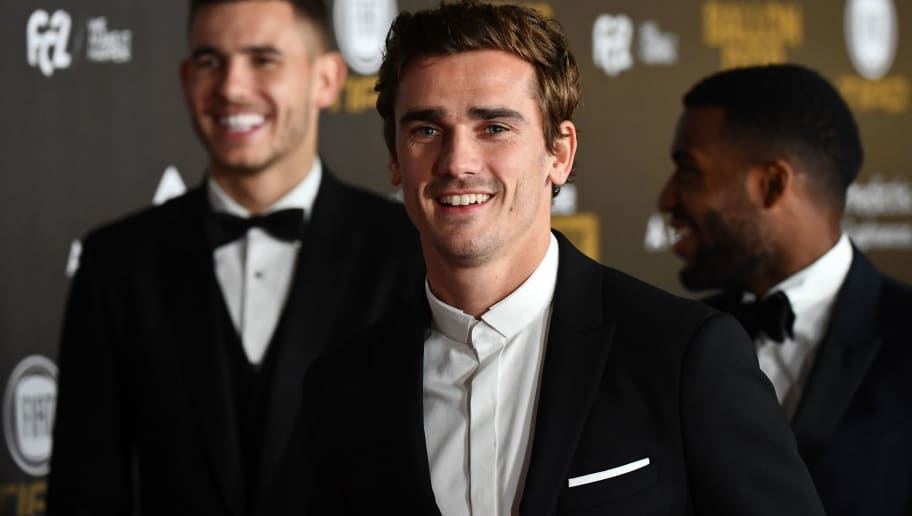 Atletico Madrid's French forward Antoine Griezmann (C) arrives at the 2018 Ballon d'Or award ceremony at the Grand Palais in Paris on December 3, 2018. (Photo by FRANCK FIFE / AFP)        (Photo credit should read FRANCK FIFE/AFP/Getty Images)