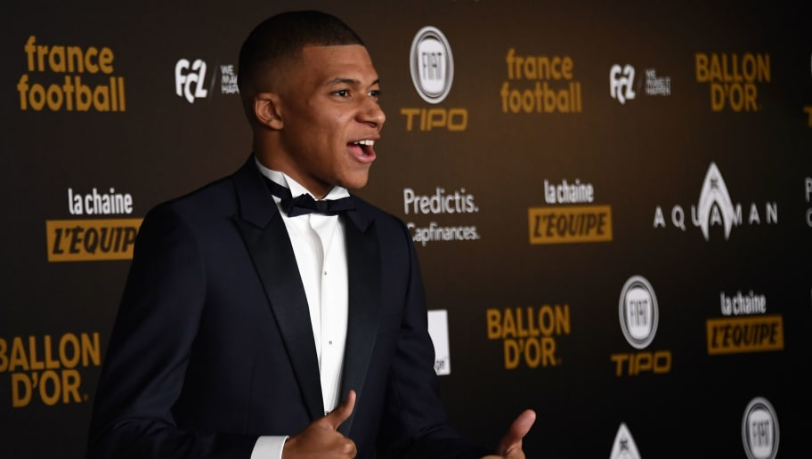 Paris Saint-Germain's French forward Kylian Mbappe poses upon arrival at the 2018  Ballon d'Or award ceremony at the Grand Palais in Paris on December 3, 2018. (Photo by Anne-Christine POUJOULAT / AFP)        (Photo credit should read ANNE-CHRISTINE POUJOULAT/AFP/Getty Images)