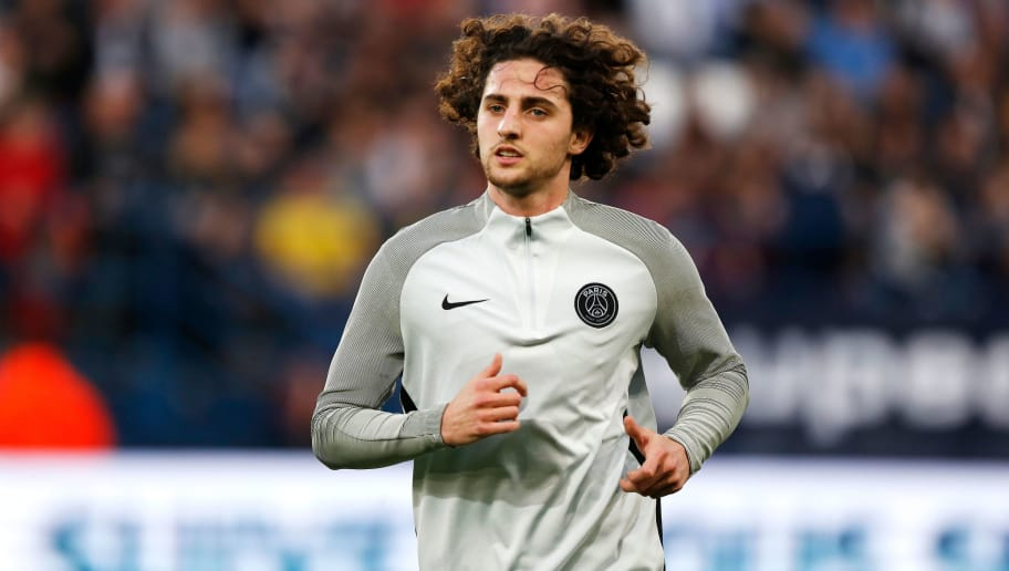 Paris Saint-Germain's French midfielder Adrien Rabiot warms up before the French cup semi-final match between Caen (SMC) and Paris Saint-Germain (PSG) on April 18, 2018 at the Michel-d'Ornano stadium in Caen, northwestern France. / AFP PHOTO / CHARLY TRIBALLEAU        (Photo credit should read CHARLY TRIBALLEAU/AFP/Getty Images)