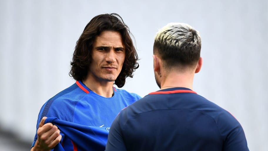 Paris Saint-Germain's Uruguayan forward Edinson Cavani (L) arrives for a training session at the Stade de France in Saint-Denis, northern Paris, on May 7, 2018 on the eve of the French Cup final football match between Paris Saint-Germain (PSG) and Les Herbiers. (Photo by FRANCK FIFE / AFP)        (Photo credit should read FRANCK FIFE/AFP/Getty Images)