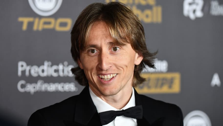 Real Madrid's Croatian midfielder Luka Modric poses upon arrival at the 2018 FIFA Ballon d'Or award ceremony at the Grand Palais in Paris on December 3, 2018. - The winner of the 2018 Ballon d'Or will be revealed at a glittering ceremony in Paris on December 3 evening, with Croatia's Luka Modric and a host of French World Cup winners all hoping to finally end the 10-year duopoly of Cristiano Ronaldo and Lionel Messi. (Photo by FRANCK FIFE / AFP)        (Photo credit should read FRANCK FIFE/AFP/Getty Images)