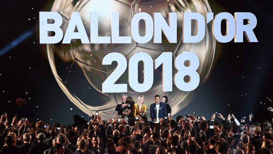 2018 FIFA Ballon d'Or awarded for best player of the year, Men's Ballon d'Or Real Madrid's Croatian midfielder Luka Modric (2ndL) is congratulated by former French footballer and host David Ginola (L) past Women's Ballon d'Or Olympique Lyonnais' Norwegian forward Ada Hegerberg (C) and Under-21 Ballon d'Or (Kopa trophy) Paris Saint-Germain's French forward Kylian Mbappe (2ndR) at the end of the 2018 FIFA Ballon d'Or award ceremony at the Grand Palais in Paris on December 3, 2018. - The winner of the 2018 Ballon d'Or will be revealed at a glittering ceremony in Paris on December 3 evening, with Croatia's Luka Modric and a host of French World Cup winners all hoping to finally end the 10-year duopoly of Cristiano Ronaldo and Lionel Messi. (Photo by FRANCK FIFE / AFP)        (Photo credit should read FRANCK FIFE/AFP/Getty Images)