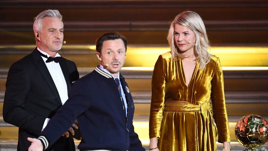 Olympique Lyonnais' Norwegian forward Ada Hegerberg (R) looks on next to French former player and presenter David Ginola and French DJ and co-host Martin Solveig (C) after receiving the women's 2018 FIFA Women's Ballon d'Or award for best player of the year during the 2018 FIFA Ballon d'Or award ceremony at the Grand Palais in Paris on December 3, 2018. - French DJ Martin Solveig apologised and said he was taken aback by the stormy reaction online after he asked the inaugural women's Ballon D'Or winner Ada Hegerberg whether she could 'twerk' live on stage. (Photo by FRANCK FIFE / AFP)        (Photo credit should read FRANCK FIFE/AFP/Getty Images)