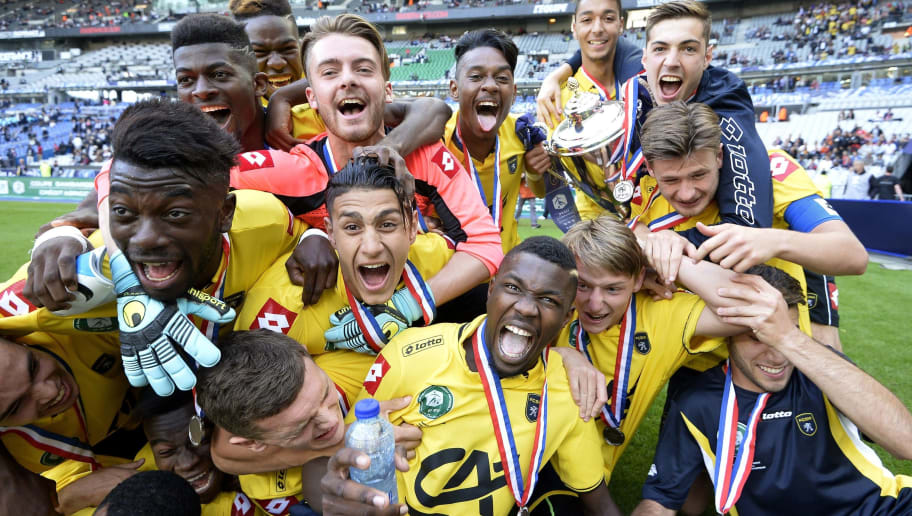 Sochaux's forward Marcus Thuram (C), son of French football legend Lilian Thuram celebrates his victory against Lyon during the French Gambardella Cup final football match between Lyon and Sochaux on May 30, 2015 at the Stade de France in Saint-Denis, north of Paris. AFP PHOTO / FRANCK FIFE        (Photo credit should read FRANCK FIFE/AFP/Getty Images)