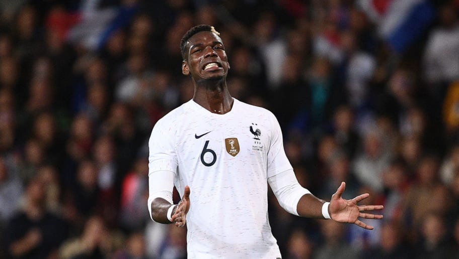 France's midfielder Paul Pogba grimaces during the friendly football match between France and Iceland at the Roudourou Stadium in Guingamp, western France on October 11, 2018. (Photo by FRANCK FIFE / AFP)        (Photo credit should read FRANCK FIFE/AFP/Getty Images)