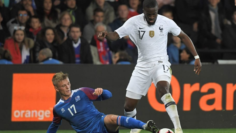Iceland's forward Albert Gudmundsson (L) vies with France's midfielder Tanguy Ndombele during the friendly football match between France and Iceland at the Roudourou Stadium in Guingamp, western France on October 11, 2018. (Photo by LOIC VENANCE / AFP)        (Photo credit should read LOIC VENANCE/AFP/Getty Images)