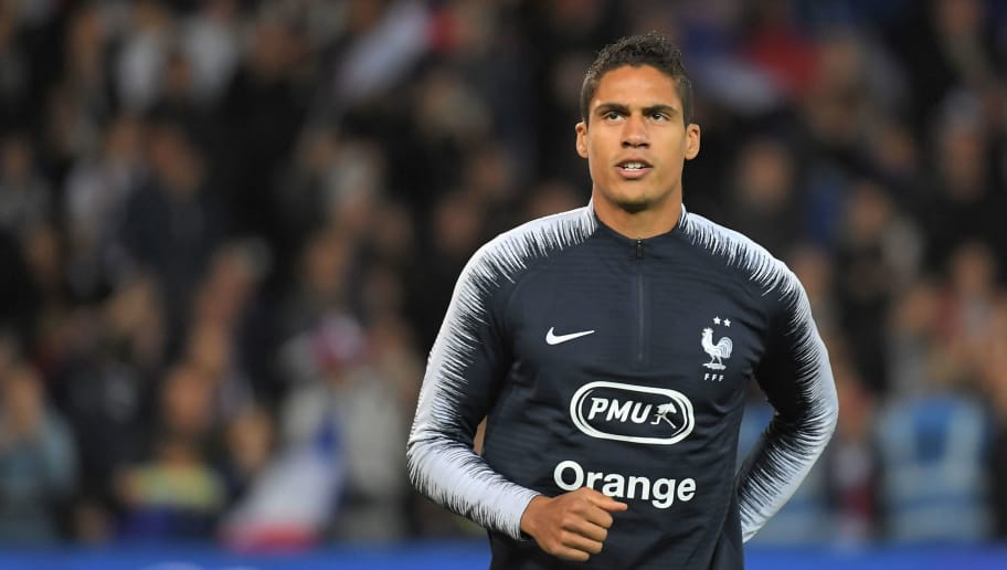 France's defender Raphael Varane warms up ahead of the friendly football match between France and Iceland at the Roudourou Stadium in Guingamp, western France on October 11, 2018. (Photo by LOIC VENANCE / AFP)        (Photo credit should read LOIC VENANCE/AFP/Getty Images)