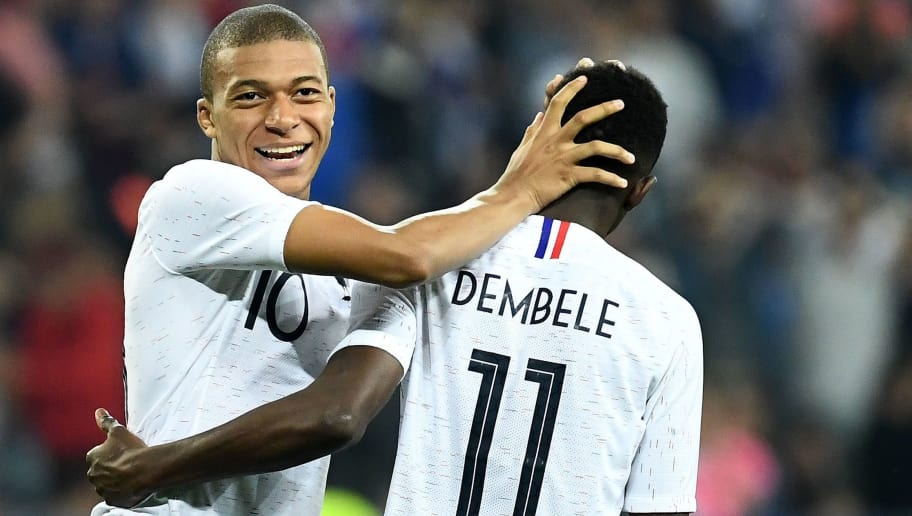 France's foward Kylian Mbappe (L) reacts with France's foward Ousmane Dembele during the friendly football match between France and Italy at the Allianz Riviera stadium in Nice, southeastern France on June 1, 2018. (Photo by FRANCK FIFE / AFP)        (Photo credit should read FRANCK FIFE/AFP/Getty Images)