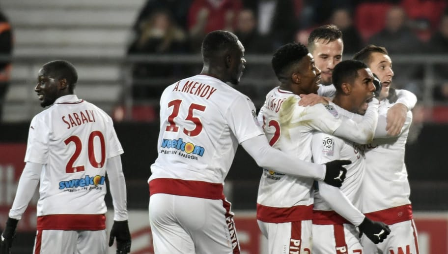 Bordeaux's Brazilian forward Malcom (2nd R) celebrates with teammates after scoring a goal during the French L1 football match between Dijon (DFCO) and Bordeaux at Gaston Gerard Stadium in Dijon on December 1, 2017. / AFP PHOTO / JEFF PACHOUD        (Photo credit should read JEFF PACHOUD/AFP/Getty Images)