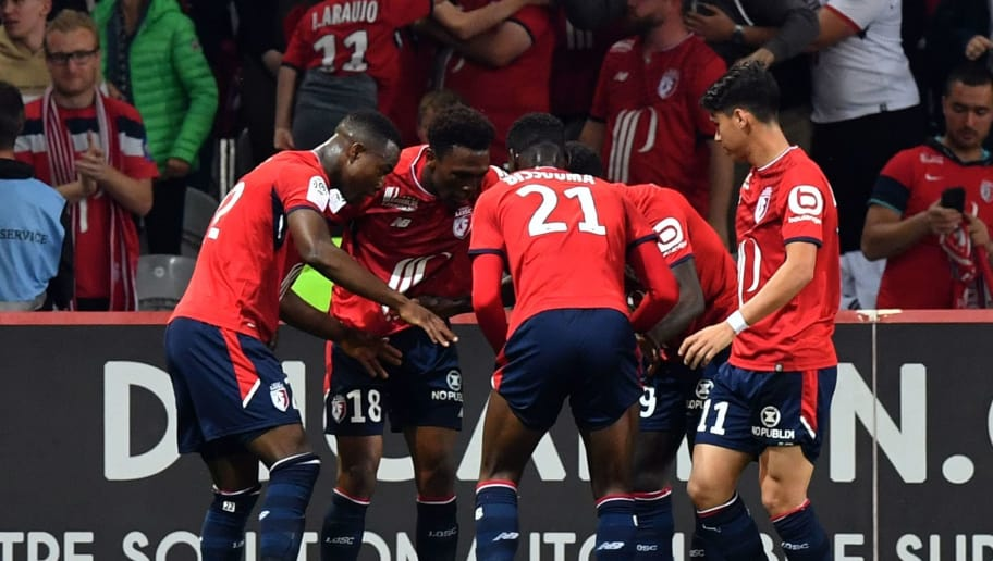 Lille's forward Lebo Mothiba celebrates with team mates after scoring during the French L1 football match between Lille OSC (LOSC) and Dijon at the Pierre-Mauroy Stadium in Villeneuve d'Ascq, near Lille, northern France on May 12, 2018. (Photo by DENIS CHARLET / AFP)        (Photo credit should read DENIS CHARLET/AFP/Getty Images)