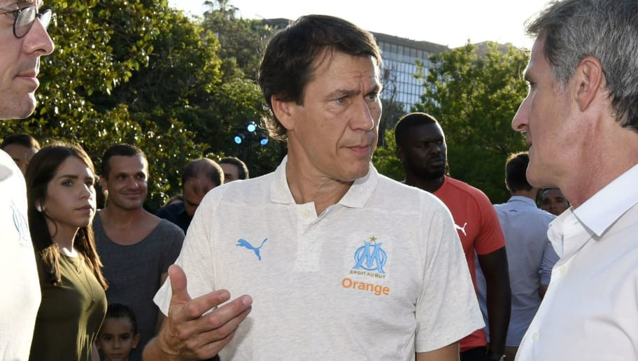 Olympique de Marseille's (OM) L1 football president Jacques-Henri Eyraud (L) speaks with OM coach Rudi Garcia and Puma France Director General Richard Tessier during the presentation of the new Olympique de Marseille jersey on July 4, 2018 in Marseille, southern France. (Photo by Franck PENNANT / AFP)        (Photo credit should read FRANCK PENNANT/AFP/Getty Images)