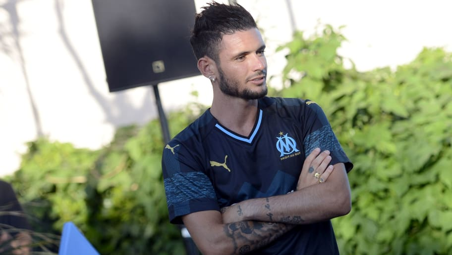 Olympique de Marseille's (OM) French forward Remy Cabella poses during the presentation of the new Olympique de Marseille jersey on July 4, 2018 in Marseille, southern France. (Photo by Franck PENNANT / AFP)        (Photo credit should read FRANCK PENNANT/AFP/Getty Images)