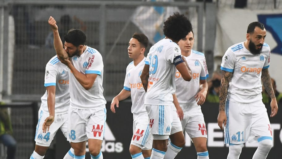 Olympique de Marseille's French midfielder Morgan Sanson (2ndL) gestures next to teammates  after scoring during the French L1 football match Olympique of Marseille (OM) against  Amiens at the Velodrome stadium in Marseille on May 19, 2018. (Photo by Boris HORVAT / AFP)        (Photo credit should read BORIS HORVAT/AFP/Getty Images)