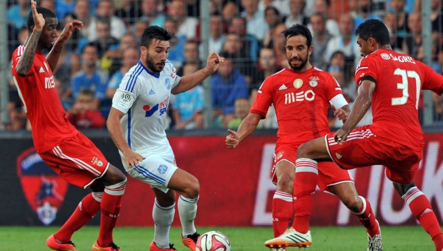Marseille's French midfielder Romain Alessandrini (2ndL) vies with Benfica players during the French Ligue 1 friendly football match between Marseille (OM) and Benfica Lisbonne, on July 23, 2014 at the Montpied Stadium in Clermont-Ferrand. AFP PHOTO / THIERRY ZOCCOLAN        (Photo credit should read THIERRY ZOCCOLAN/AFP/Getty Images)