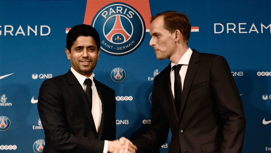 French Ligue 1 football club Paris Saint-Germain's newly appointed coach German Thomas Tuchel (R) shakes hand with club's president Nasser Al-Khelaifi at the end of a press conference to officially present him as the club's new recruit on May 20, 2018 at the Parc des Princes stadium in Paris. (Photo by Philippe LOPEZ / AFP)        (Photo credit should read PHILIPPE LOPEZ/AFP/Getty Images)