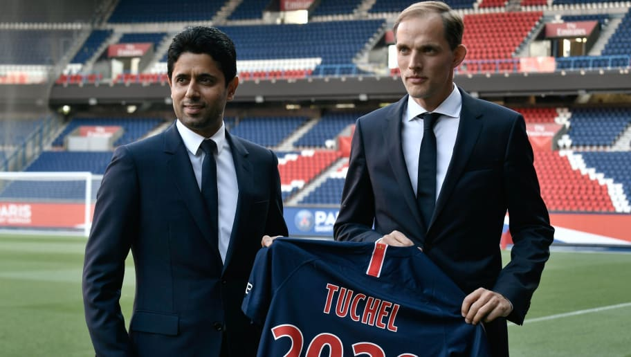 French Ligue 1 football club Paris Saint-Germain's newly appointed coach German Thomas Tuchel (R) poses with club's president Nasser Al-Khelaifi after a press conference to officially present him as the club's new recruit on May 20, 2018 at the Parc des Princes stadium in Paris. (Photo by Philippe LOPEZ / AFP)        (Photo credit should read PHILIPPE LOPEZ/AFP/Getty Images)