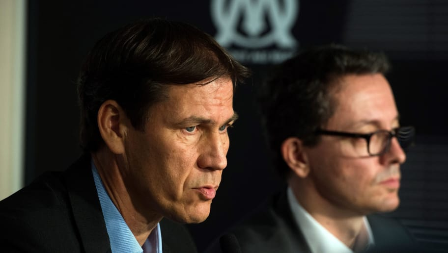Olympique de Marseille (OM) French new head coach Rudi Garcia (L) and Olympique de Marseille French President Jacques-Henri Eyraud take part in a press conference at the club's training centre in Marseille, southern France, on October 21, 2016, on October 21, 2016.  Garcia was named as the new coach of French giants Marseille on October 20, 2016, just three days after US tycoon Frank McCourt completed his purchase of the club. Garcia, 52, replaces Franck Passi. / AFP / BERTRAND LANGLOIS        (Photo credit should read BERTRAND LANGLOIS/AFP/Getty Images)