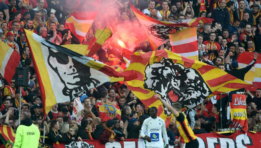Lens supporters jubilates during the French L2 football match between Lens and Niort on May 19, 2017 at the Bollaert-Delelis stadium in Lens.  / AFP PHOTO / FRANCOIS LO PRESTI        (Photo credit should read FRANCOIS LO PRESTI/AFP/Getty Images)