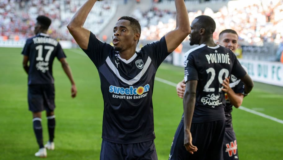 Bordeaux's Guinean forward Francois Kamano (C) celebrates after scoring a goal during the French L1 football match between Bordeaux and Monaco on August 26, 2018 at the Matmut Atlantique stadium in Bordeaux, southwestern France. (Photo by NICOLAS TUCAT / AFP)        (Photo credit should read NICOLAS TUCAT/AFP/Getty Images)