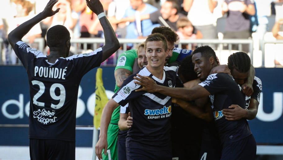 dBordeaux's Guinean forward Francois Kamano (R) celebrates after scoring a goal during the French L1 football match between Bordeaux and Monaco on August 26, 2018 at the Matmut Atlantique stadium in Bordeaux, southwestern France. (Photo by NICOLAS TUCAT / AFP)        (Photo credit should read NICOLAS TUCAT/AFP/Getty Images)