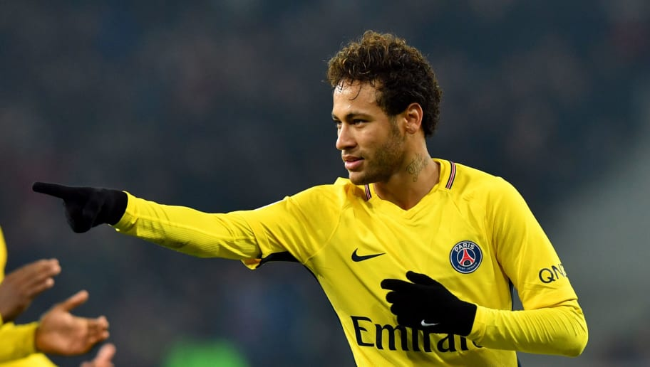 Paris Saint-Germain's Brazilian forward Neymar celebrates after scoring a goal during French L1 football match between Lille Losc and Paris Saint-Germain (PSG), at the Pierre-Mauroy stadium, in Villeneuve-d'Ascq, on February 3, 2018. / AFP PHOTO / DENIS CHARLET        (Photo credit should read DENIS CHARLET/AFP/Getty Images)