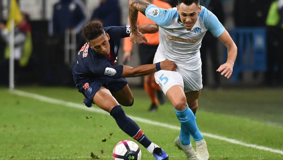 Marseille's Argentine midfielder Lucas Ocampos (R) vies for the ball with Paris Saint-Germain's German defender Thilo Kehrer (L) during the French L1 football match between Olympique de Marseille (OM) and Paris Saint-Germain (PSG) at the Velodrome stadium, in Marseille, on October 28, 2018. (Photo by Boris HORVAT / AFP)        (Photo credit should read BORIS HORVAT/AFP/Getty Images)