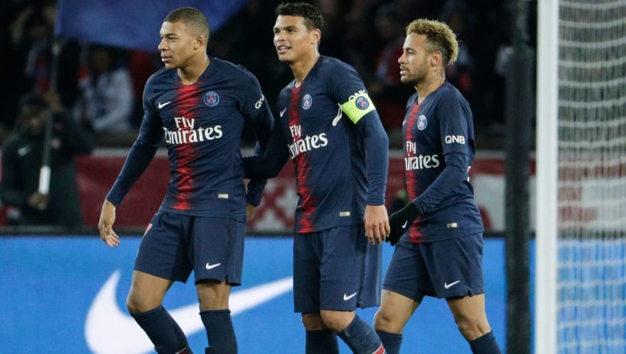 (From L) Paris Saint-Germain's French forward Kylian Mbappe, Paris Saint-Germain's Brazilian defender Thiago Silva and Paris Saint-Germain's Brazilian forward Neymar celebrate after winning at the end of the French L1 football match between Paris Saint-Germain (PSG) and Lille (LOSC) at the Parc des Princes stadium, in Paris, November 2, 2018. (Photo by Geoffroy VAN DER HASSELT / AFP)        (Photo credit should read GEOFFROY VAN DER HASSELT/AFP/Getty Images)