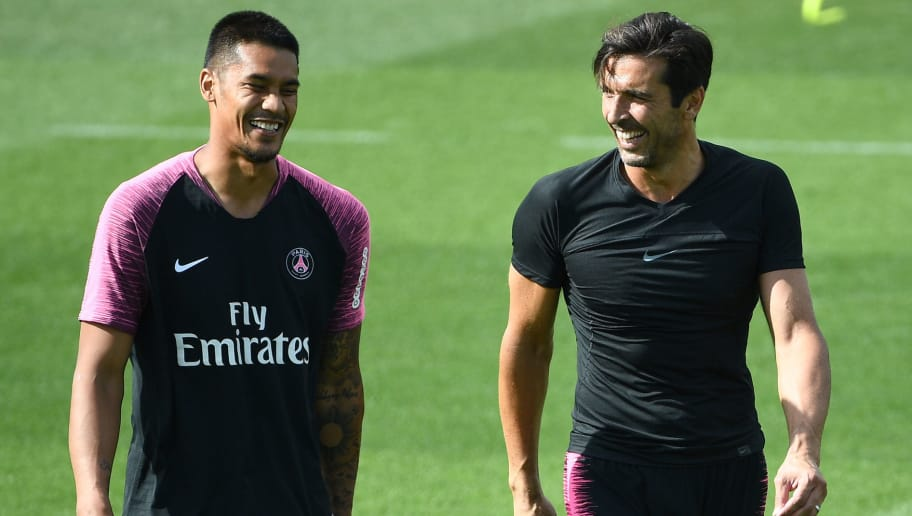 Paris Saint-Germain's French goalkeeper Alphonse Areola (L) speaks and laughs with Paris Saint-Germain's Italian goalkeeper Gianluigi Buffon (R) during a training session of the Paris Saint-Germain football team on August 24, 2018 at the Camp des Loges, in Saint-Germain-en-Laye, on the outskirts of Paris, on the eve of their French L1 football match. (Photo by FRANCK FIFE / AFP)        (Photo credit should read FRANCK FIFE/AFP/Getty Images)