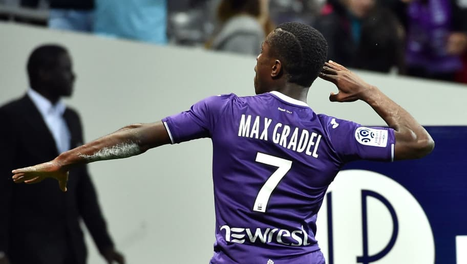 Toulouse's French forward Max-Alain Gradel celebrates after scoring his team's first goal during the French L1 football match between Toulouse and Guingamp at The Municipal Stadium in Toulouse, southern France on May 19, 2018. (Photo by REMY GABALDA / AFP)        (Photo credit should read REMY GABALDA/AFP/Getty Images)