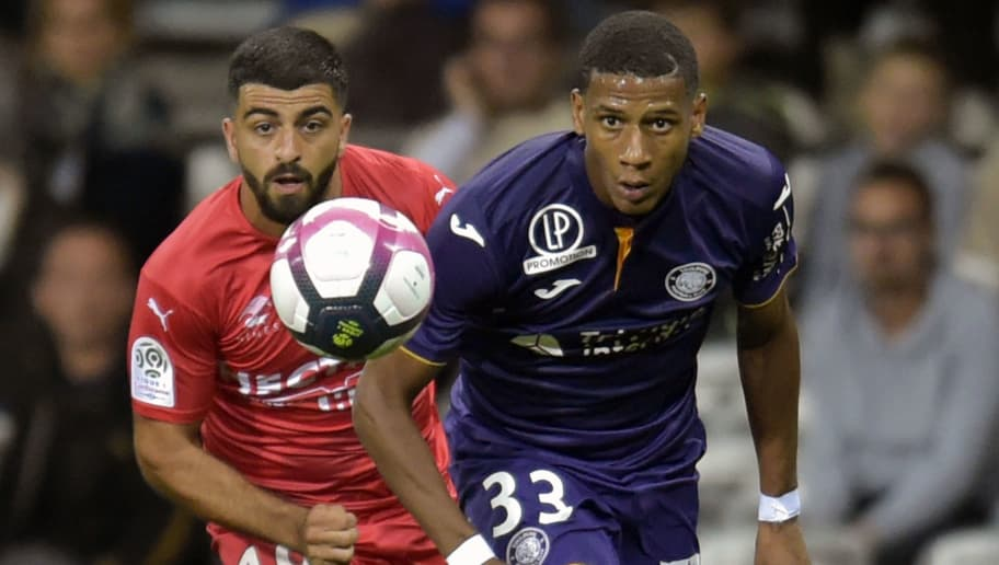 Toulouse's French defender Jean-Clair Todibo (R) vies for the ball with Nimes's Turkish forward Umut Bozok (L) during the French L1 football match between Toulouse and Nimes, on August 25, 2018, at the Municipal Stadium, in Toulouse, southern France. (Photo by PASCAL PAVANI / AFP)        (Photo credit should read PASCAL PAVANI/AFP/Getty Images)
