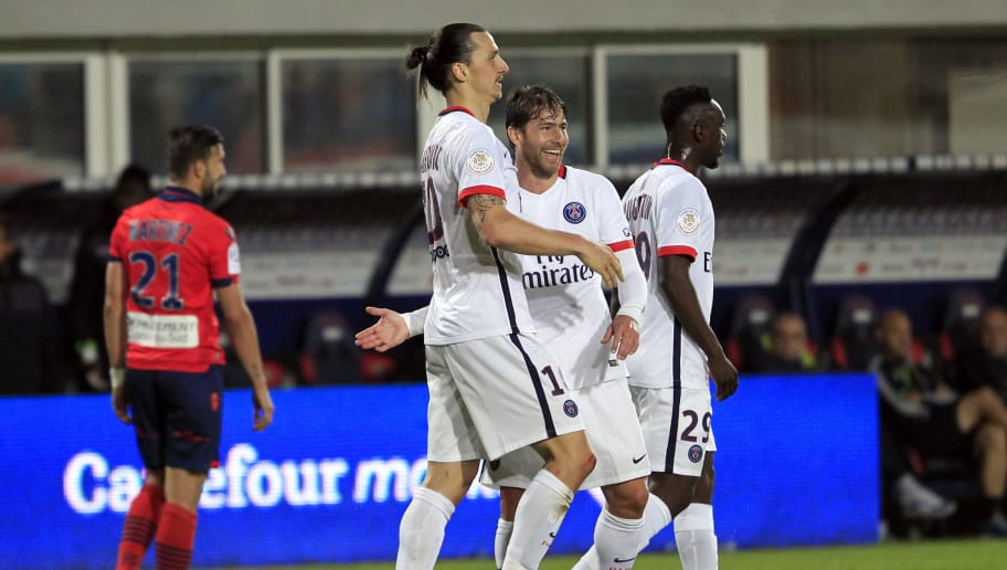 Paris Saint-Germain's Swedish forward Zlatan Ibrahimovic is congratulated by teammate and defender Sherrer Maxwell after scoring a goal during the L1 football match Gazelec Ajaccio (GFCA) against Paris Saint Germain (PSG) on May 7, 2016, at the Ange Casanova stadium in Ajaccio, on the French Mediterranean island of Corsica. AFP PHOTO / PASCAL POCHARD-CASABIANCA / AFP / PASCAL POCHARD-CASABIANCA        (Photo credit should read PASCAL POCHARD-CASABIANCA/AFP/Getty Images)