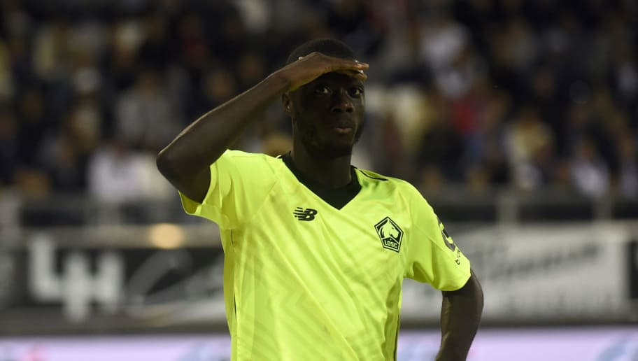 Lille's Ivorian forward Nicolas Pepe celebrates after scoring a goal during the French L1 football match between Amiens and Lille at the Licorne stadium in Amiens, northern France, on August 26, 2018. (Photo by FRANCOIS LO PRESTI / AFP)        (Photo credit should read FRANCOIS LO PRESTI/AFP/Getty Images)