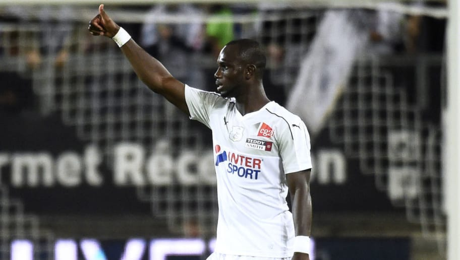 Amiens' Cameroonian forward Moussa Konate (L) celebrates after scoring a goal  during the French L1 football match between Amiens (ASC) and Reims (SR) on August 25, 2018, at the Licorne stadium in Amiens, northern France. (Photo by FRANCOIS LO PRESTI / AFP)        (Photo credit should read FRANCOIS LO PRESTI/AFP/Getty Images)