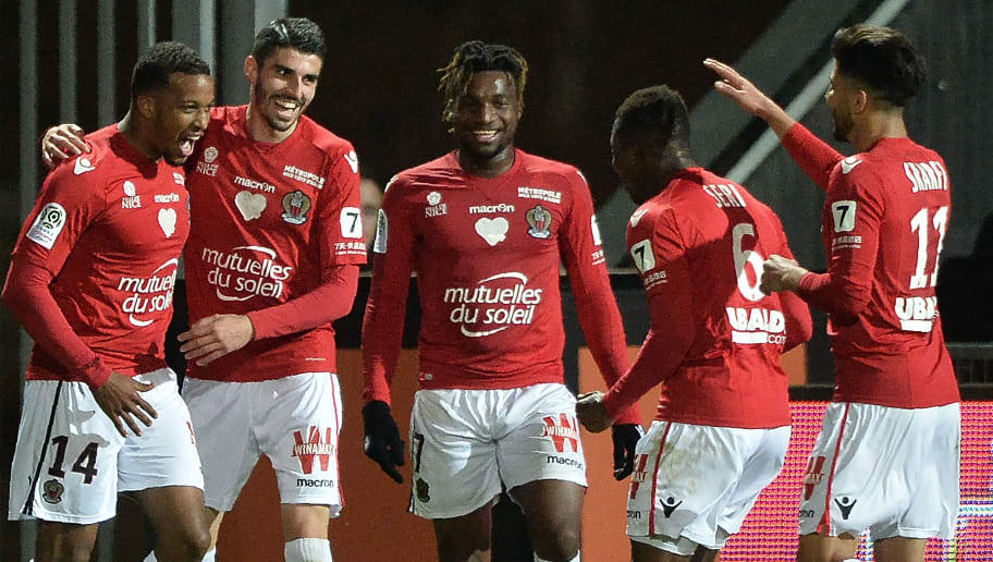 Nice's French forward Alassane Plea (L) is congratulated by teammates after scoring a goal during the French L1 football match between Angers (SCO) and Nice (OGC), on April 13, 2018, at Raymond-Kopa Stadium, in Angers, northwestern France.  / AFP PHOTO / JEAN-FRANCOIS MONIER        (Photo credit should read JEAN-FRANCOIS MONIER/AFP/Getty Images)