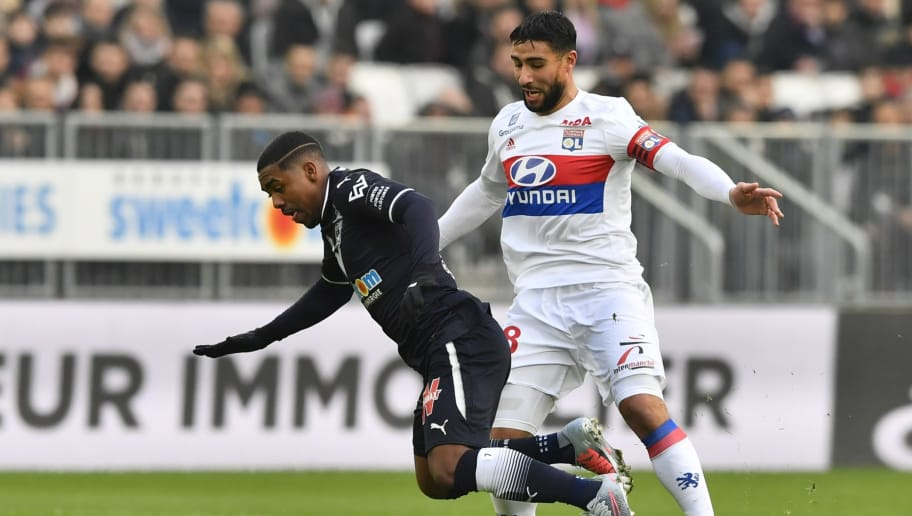 Bordeaux's Brazilian forward Malcom (L) is fouled by Lyon's French midfielder Nabil Fekir (R) during the French L1 football match between Bordeaux (FCGB) and Lyon (OL) on January 28, 2018, at the Matmut Atlantique stadium in Bordeaux, southwestern France. / AFP PHOTO / NICOLAS TUCAT        (Photo credit should read NICOLAS TUCAT/AFP/Getty Images)