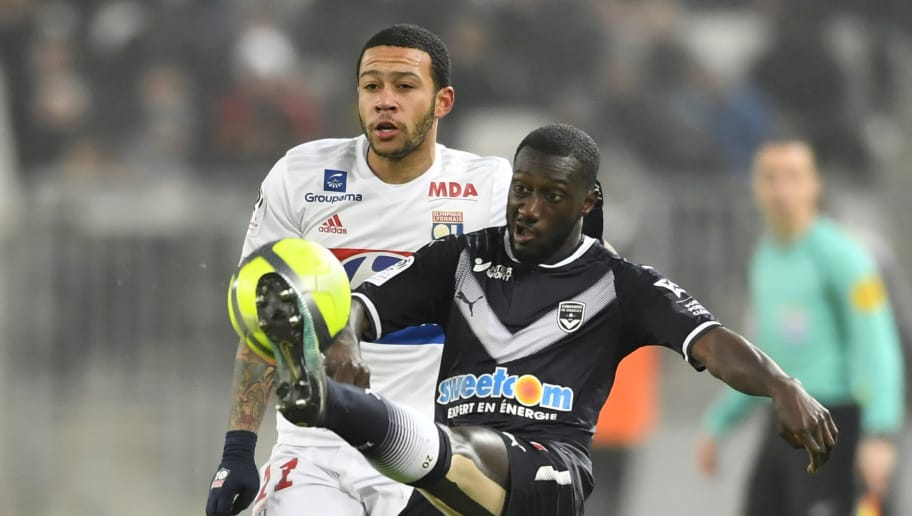 Bordeaux's French defender Youssouf Sabaly (R) vies with Lyon's Dutch forward Memphis Depay during the French L1 football match between Bordeaux (FCGB) and Lyon (OL) on January 28, 2018 at the Matmut Atlantique stadium in Bordeaux, southwestern France.  / AFP PHOTO / NICOLAS TUCAT        (Photo credit should read NICOLAS TUCAT/AFP/Getty Images)