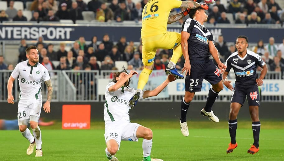 Saint-Etienne's French goalkeeper Stephane Ruffier (C) hits his teammate Saint-Etienne's Serbian defender Neven Subotic (2ndR) during the French L1 football match between FC Girondins de Bordeaux and AS Saint-Etienne at the Matmut Atlantique stadium in Bordeaux, southwestern France on December 5, 2018. (Photo by NICOLAS TUCAT / AFP)        (Photo credit should read NICOLAS TUCAT/AFP/Getty Images)