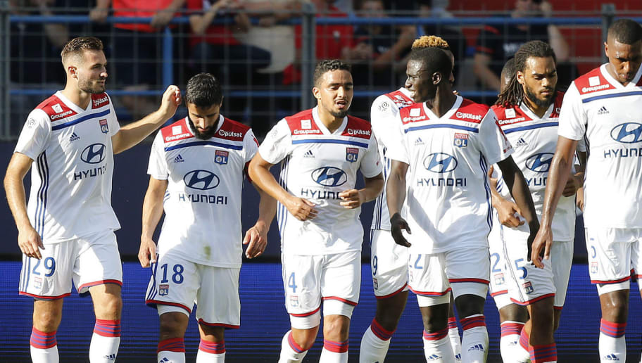 Lyon's French midfielder Nabil Fekir (2ndL) celebrates with teammates after scoring a goal during the French L1 football match between Caen (SMC) and Lyon (OL) on September 15, 2018, at the Michel d'Ornano stadium, in Caen, (Photo by CHARLY TRIBALLEAU / AFP)        (Photo credit should read CHARLY TRIBALLEAU/AFP/Getty Images)
